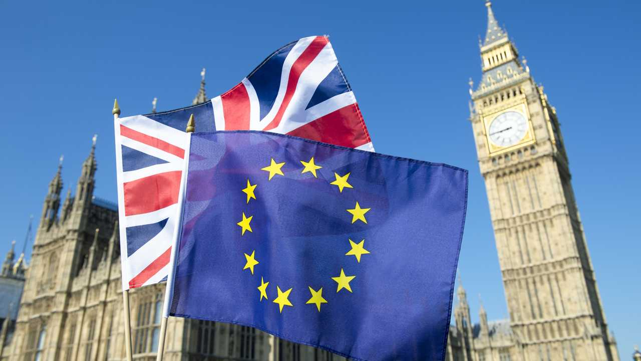 EU and British flag in front of Big Ben and Houses of Parliament in London