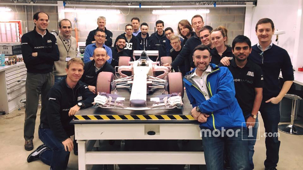 Manor wind tunnel model car with the team