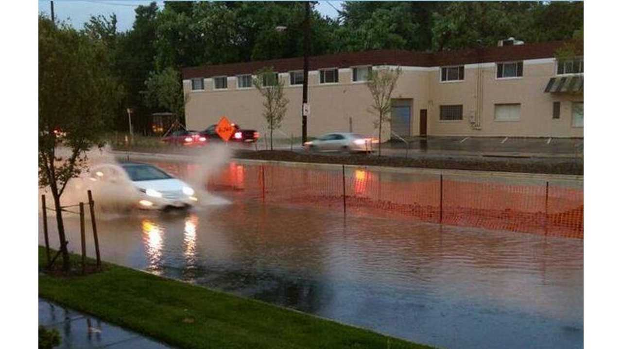 Chevy Volt Blasts Down A Flooded Street