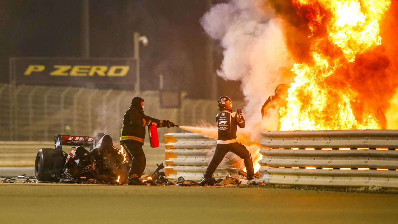 Romain Grosjean getting out of his car that is on fire at Bahrain GP 2020