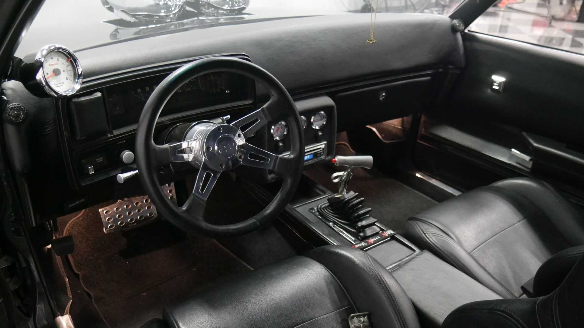 """[""""1978 Chevrolet Malibu Is A Fully Decked-Out Metallic Beauty""""]"""