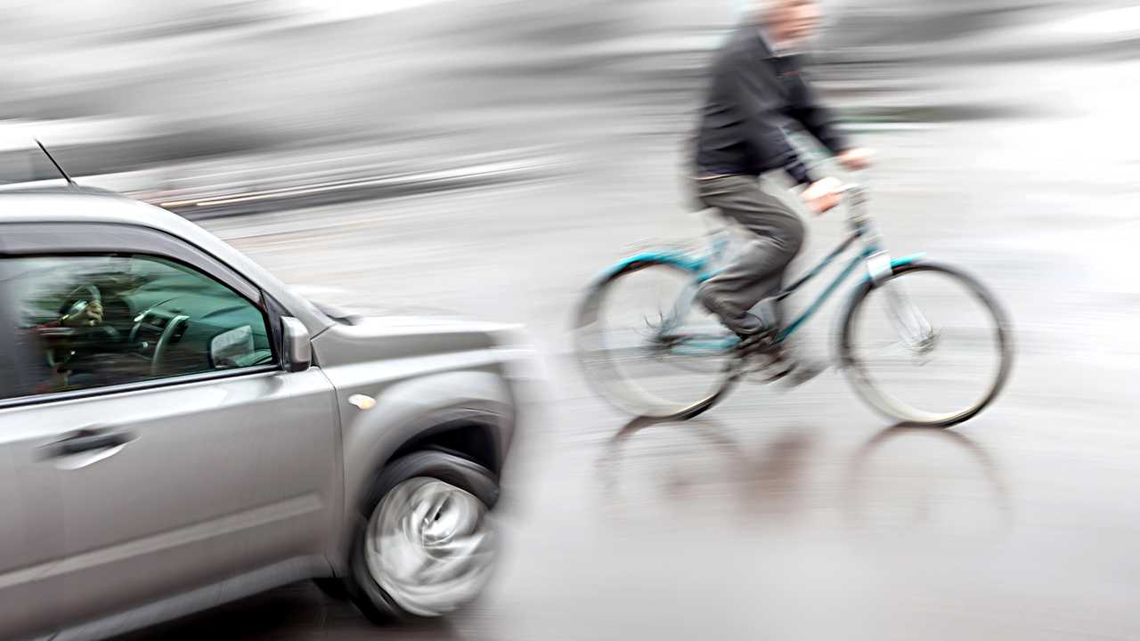 Dangerous traffic situation with cyclist and car