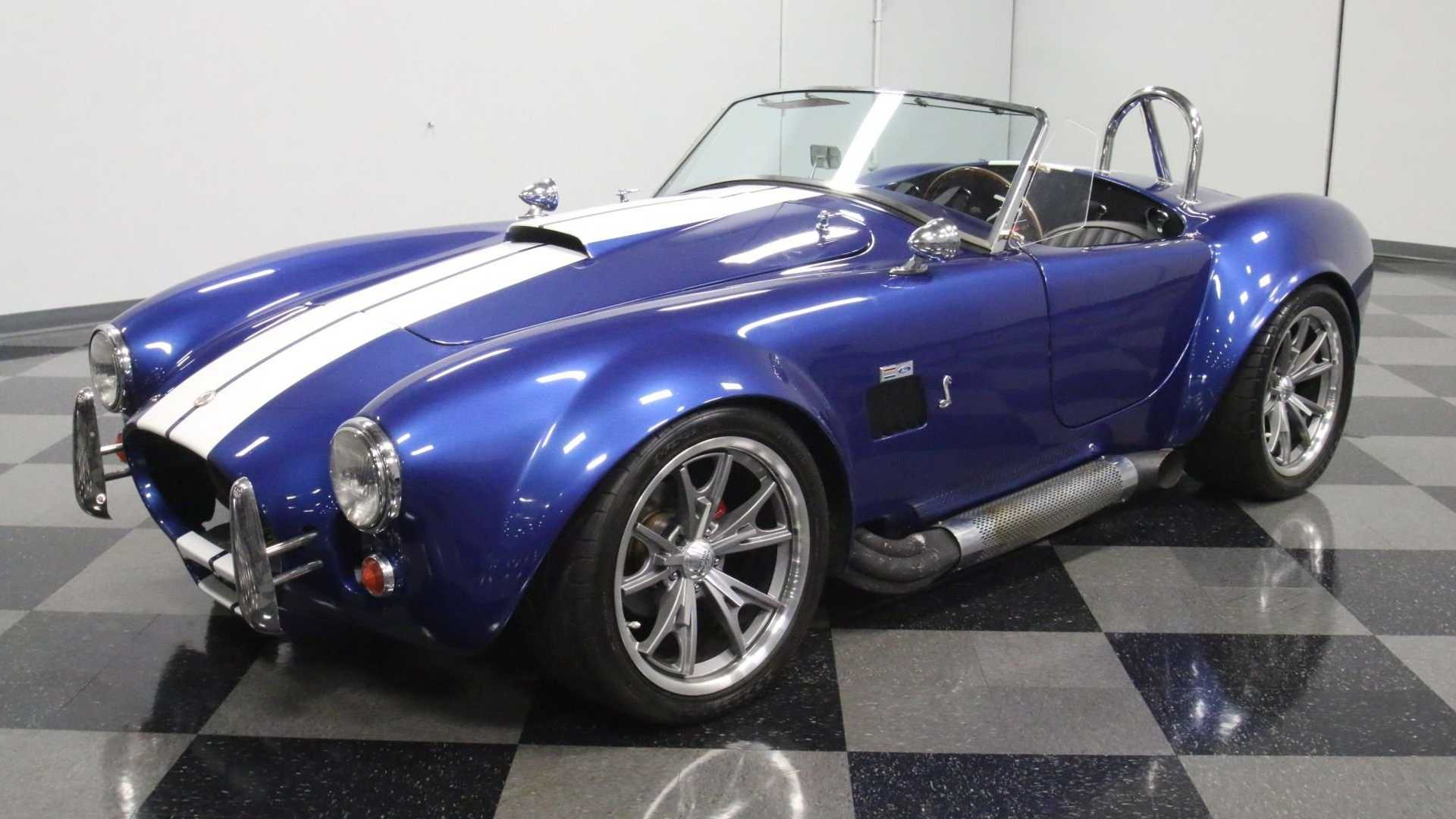 "[""Wow The Crowd In This 1965 Shelby Cobra Everett-Morrison""]"