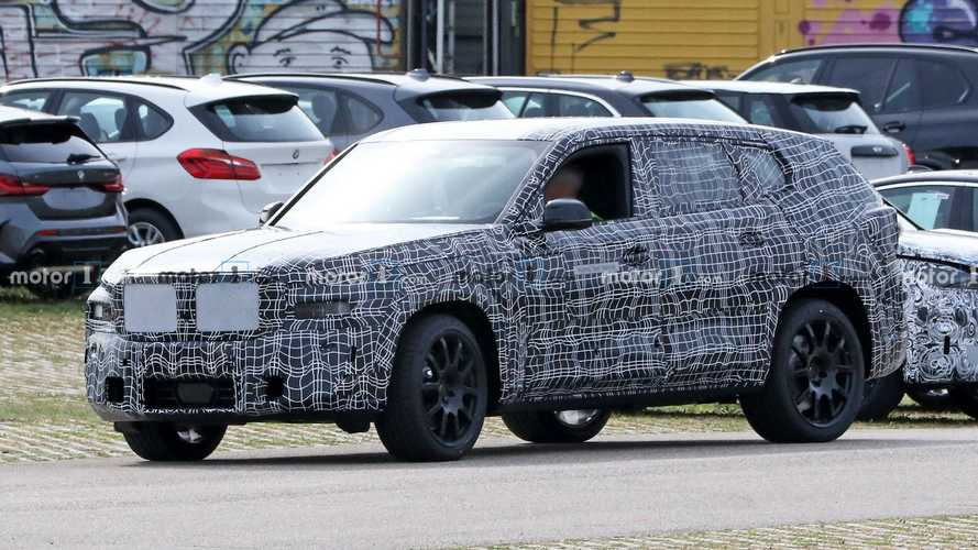 BMW X8 spied for first time with unique design under thick camouflage
