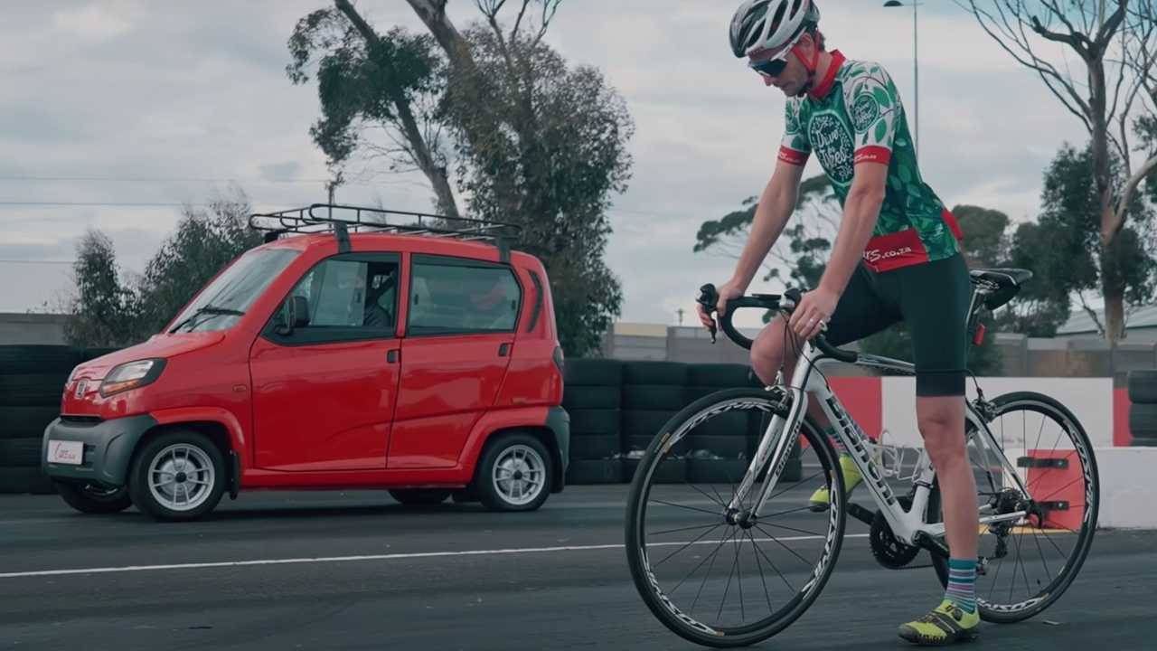 Bajaj Qute vs Bicycle Drag Race