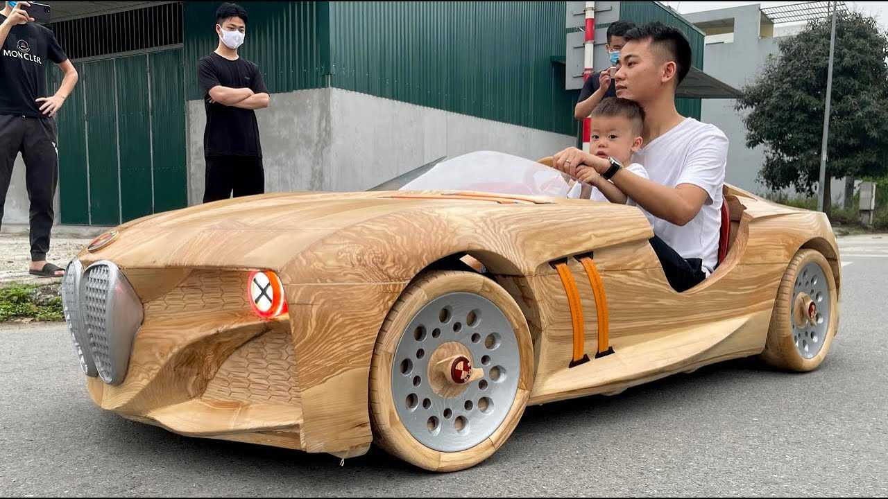 Screenshot from the video showing this fantastic wooden BMW-styled kid-sized car.