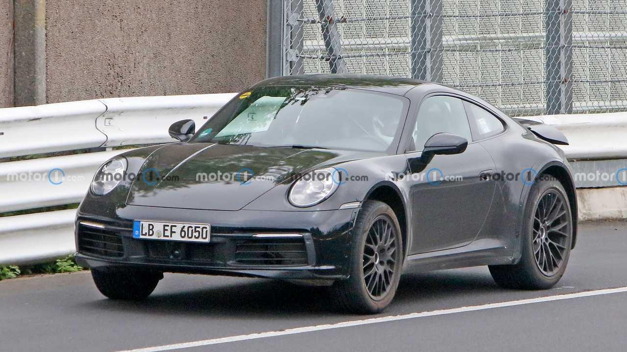 Porsche 911 prototype with lifted suspension spy photo