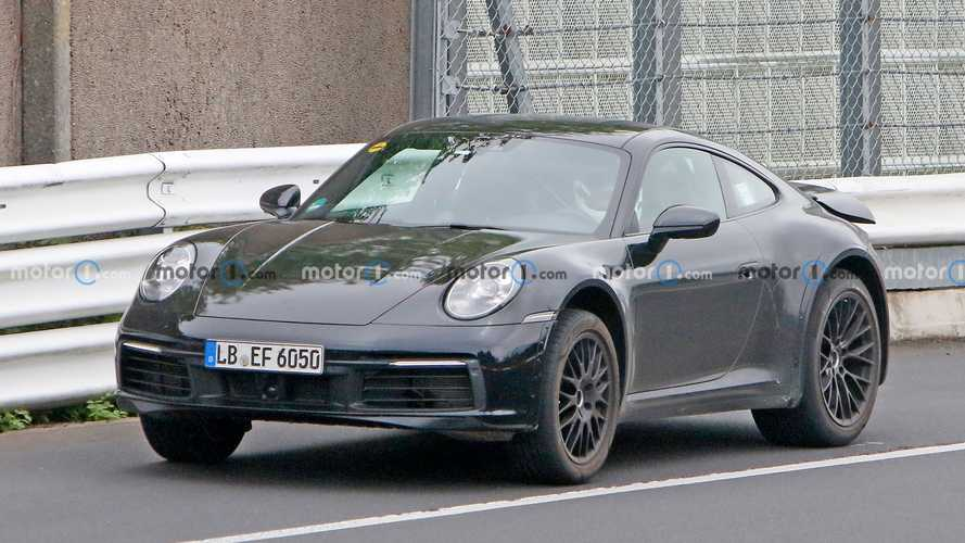Porsche 911 prototype spied with lifted suspension, chunky arches