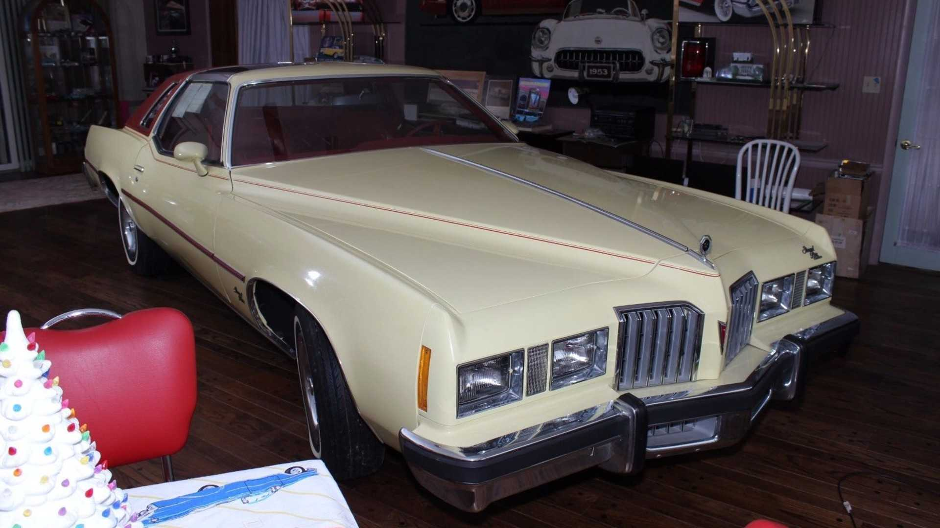 """[""""1. 1977 Pontiac Grand Prix with only 123 miles from new""""]"""
