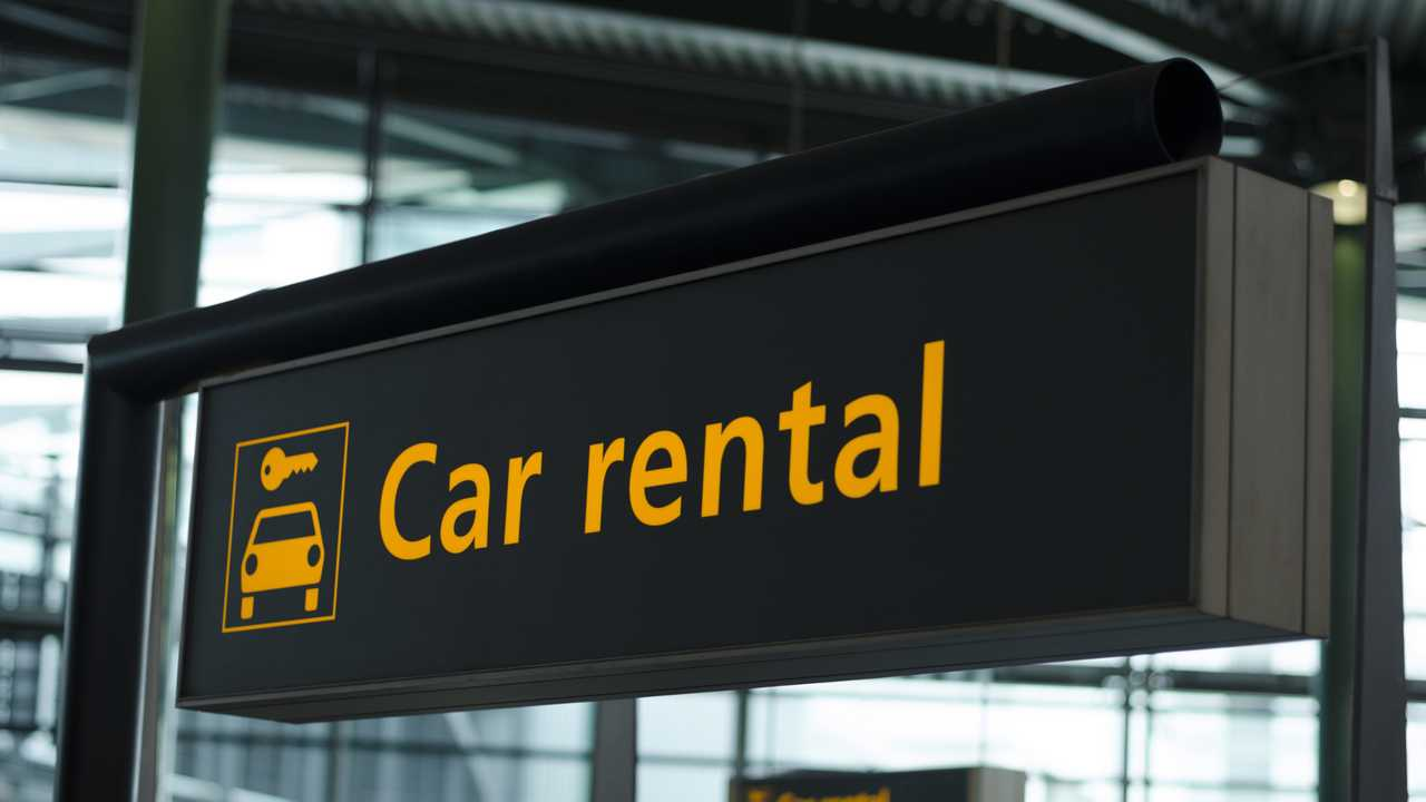 Sign with direction to car rental