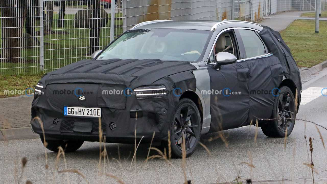 Genesis GV70e spy photo (front three-quarters)