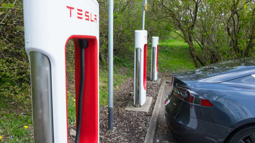 Tesla car by supercharger at M7 motorway services in Abington Scotland
