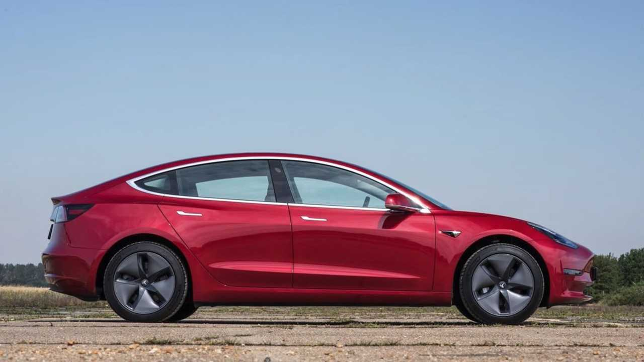 tesla model 3 red side view