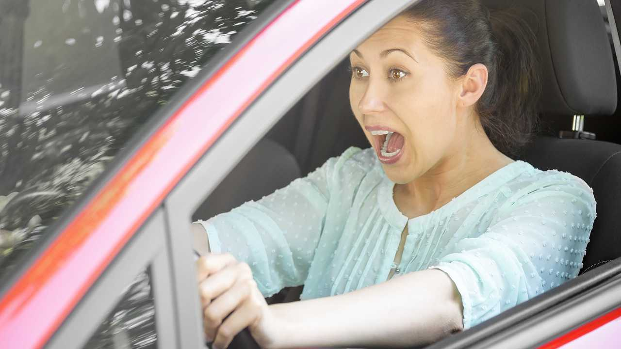 Woman driver startled as she suddenly brakes to avoid accident