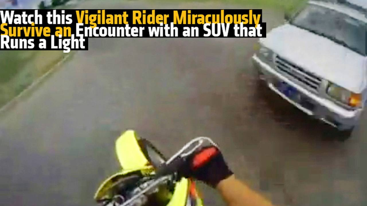 Watch this Vigilant Rider Miraculously Survive an Encounter with an SUV that Runs a Light