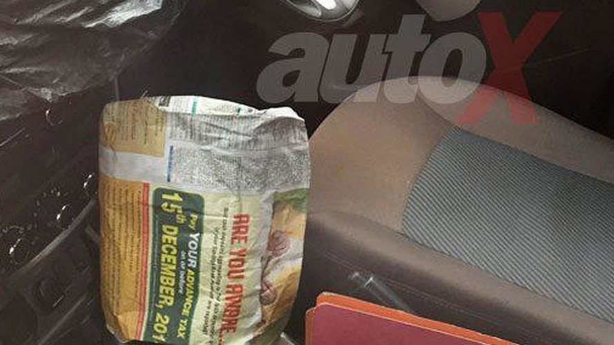 Renault India uses newspaper to hide automatic gearbox on Duster facelift prototype