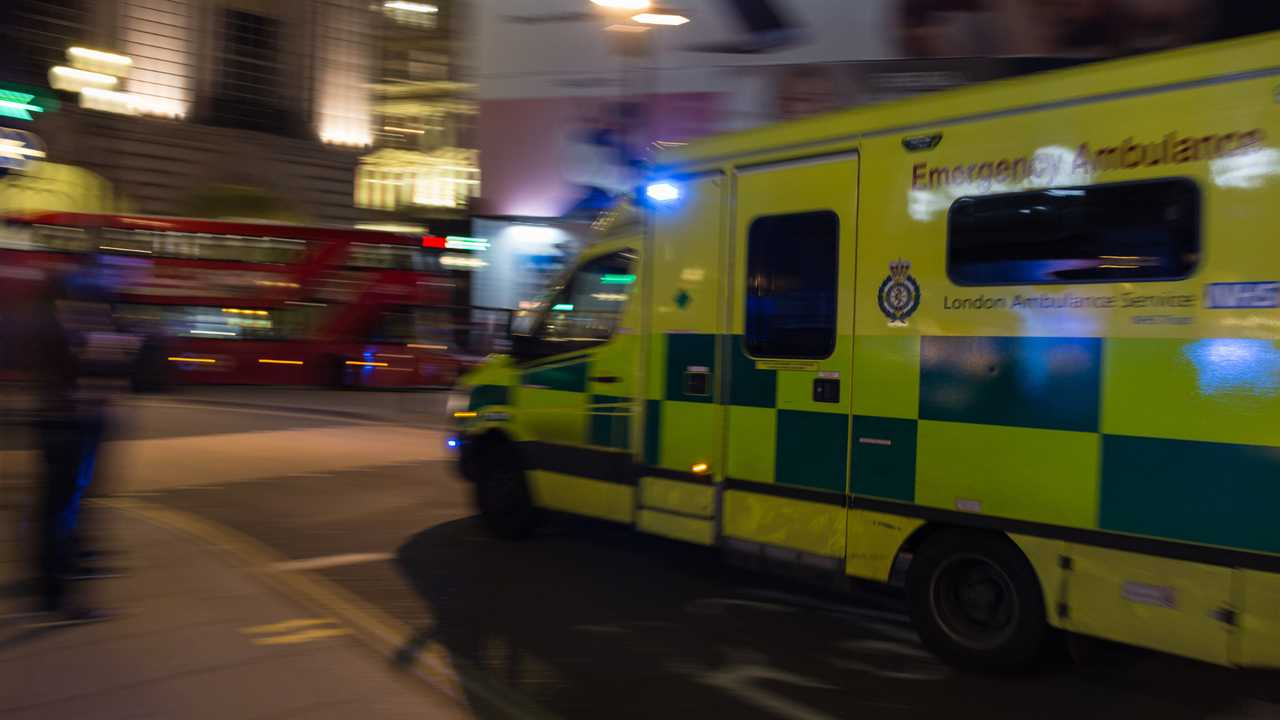 Emergency ambulance of UK in action at night