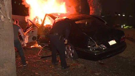 LA man survives car flying off overpass, bursting into flames
