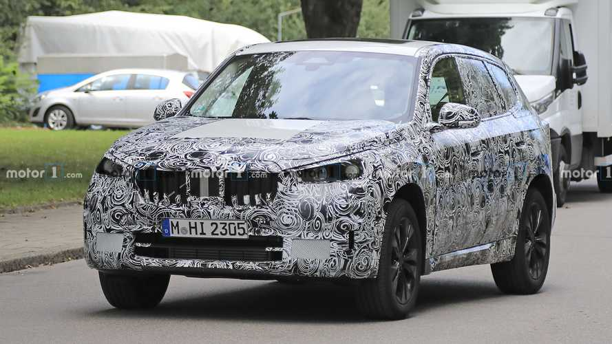 2022 BMW X1 spied with glass roof, large grilles, and hidden exhausts
