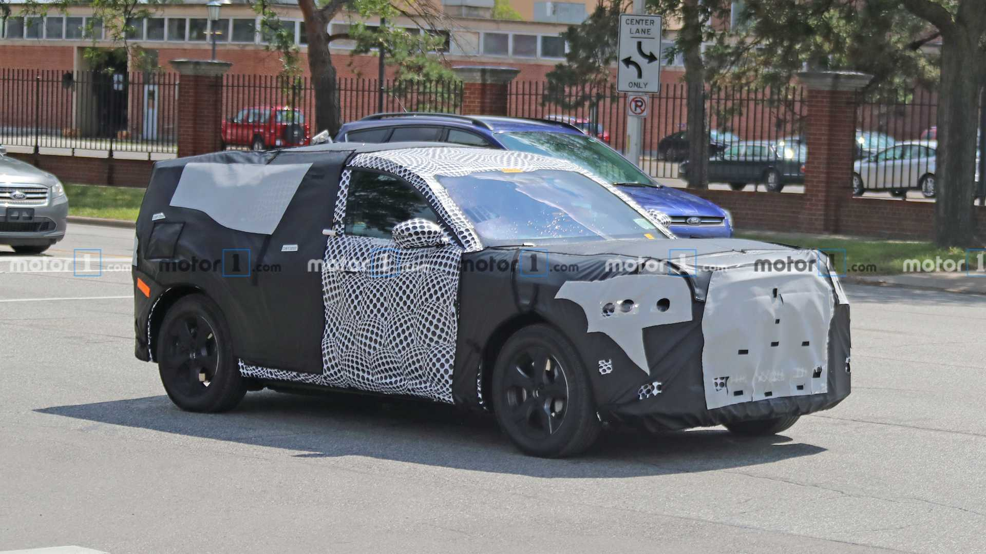 ford mustang inspired electric suv spied wearing production metal