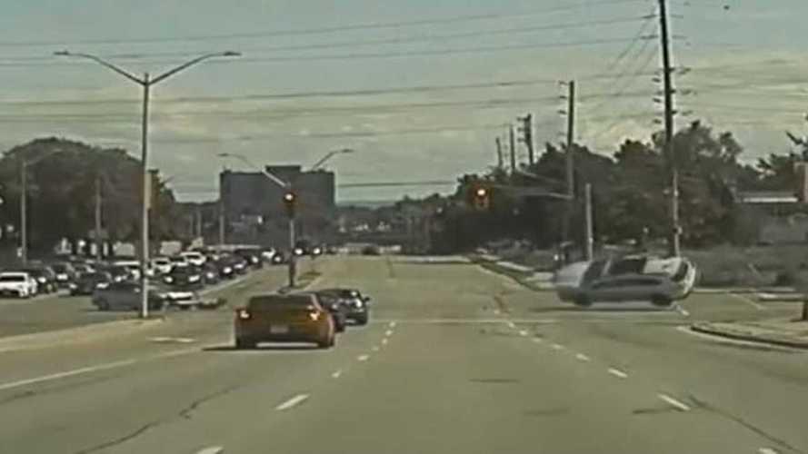 Caught On Camera: Tesla Witnesses Red-Light Running SUV Rollover Wreck