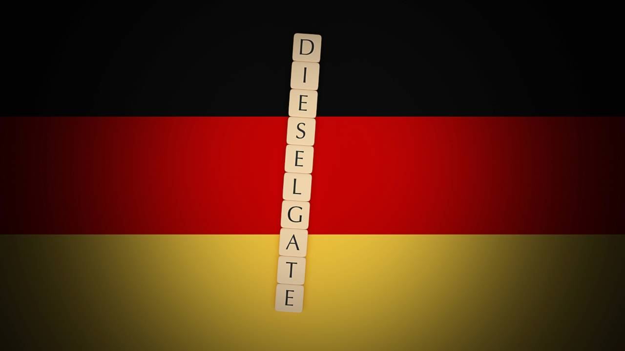 Dieselgate spelled in letter tiles on German flag