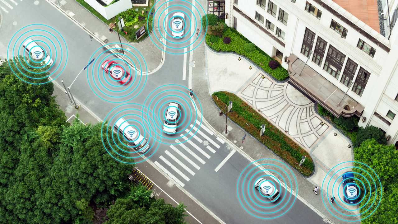 Autonomous self driving cars illustration showing radar sensor system and internet signals on city street
