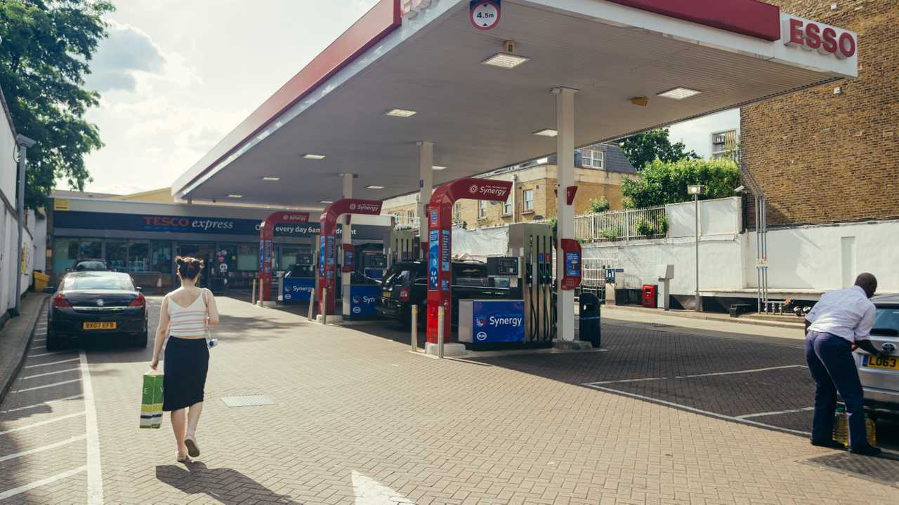 Esso petrol station and Tesco express convenience store in London