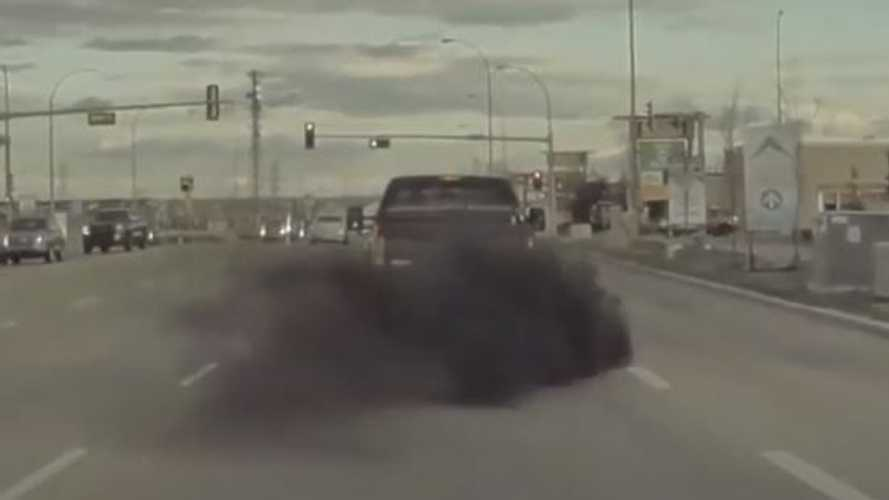 Watch Diesel Truck Block Road To Purposely Roll Coal On Tesla Model 3