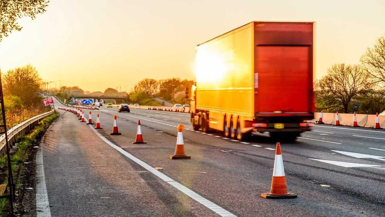Lorry passing motorway services roadworks cones