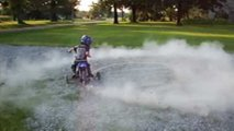 watch this mini motocross do some dirty donuts