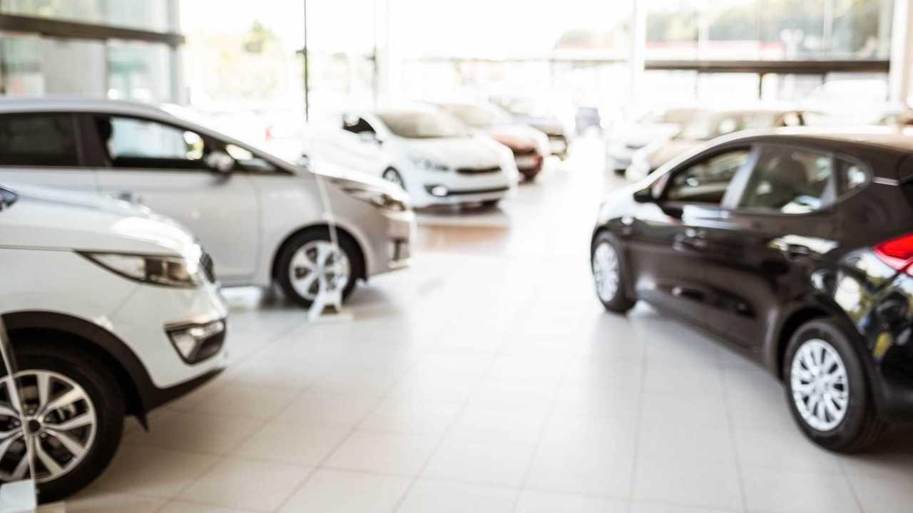 New cars in car dealership showroom