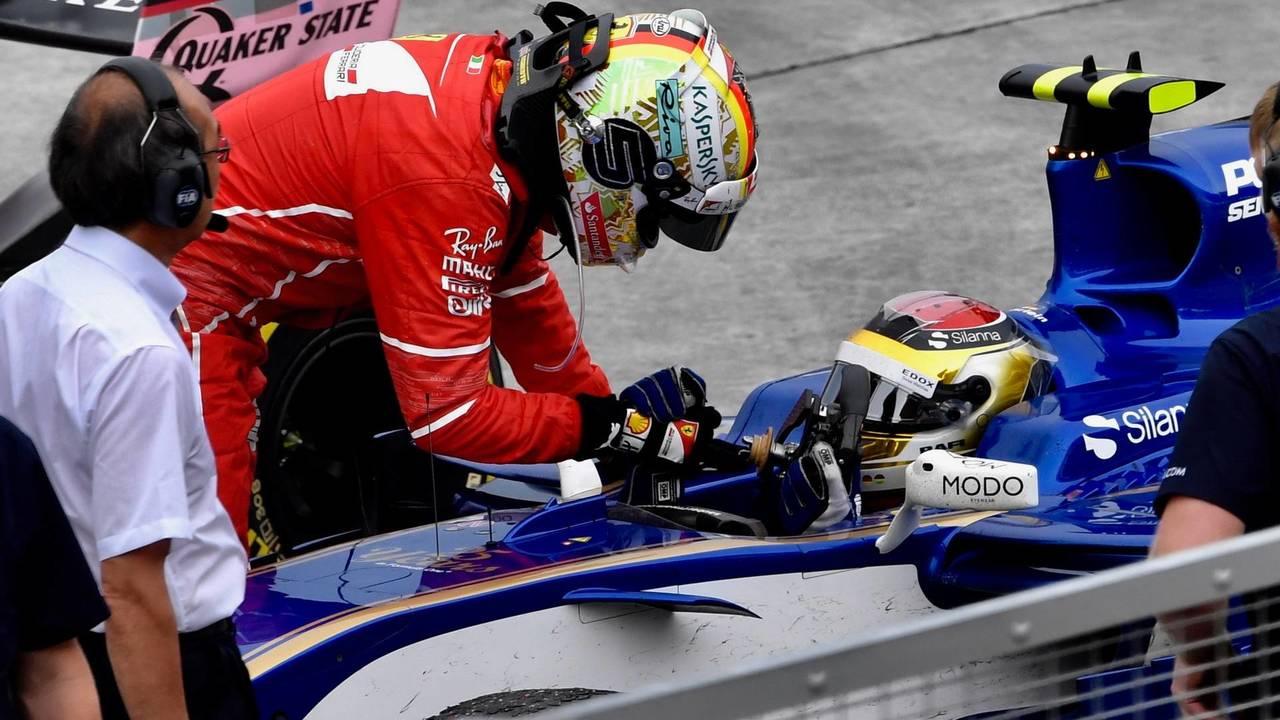 Sepang 2017: Pascal Wehrlein (Sauber) y Sebastian Vettel (Ferrari)