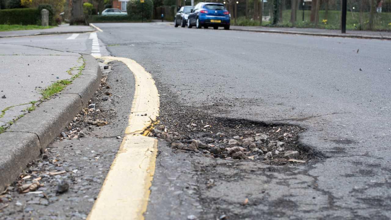 Pothole in road Croydon, Greater London