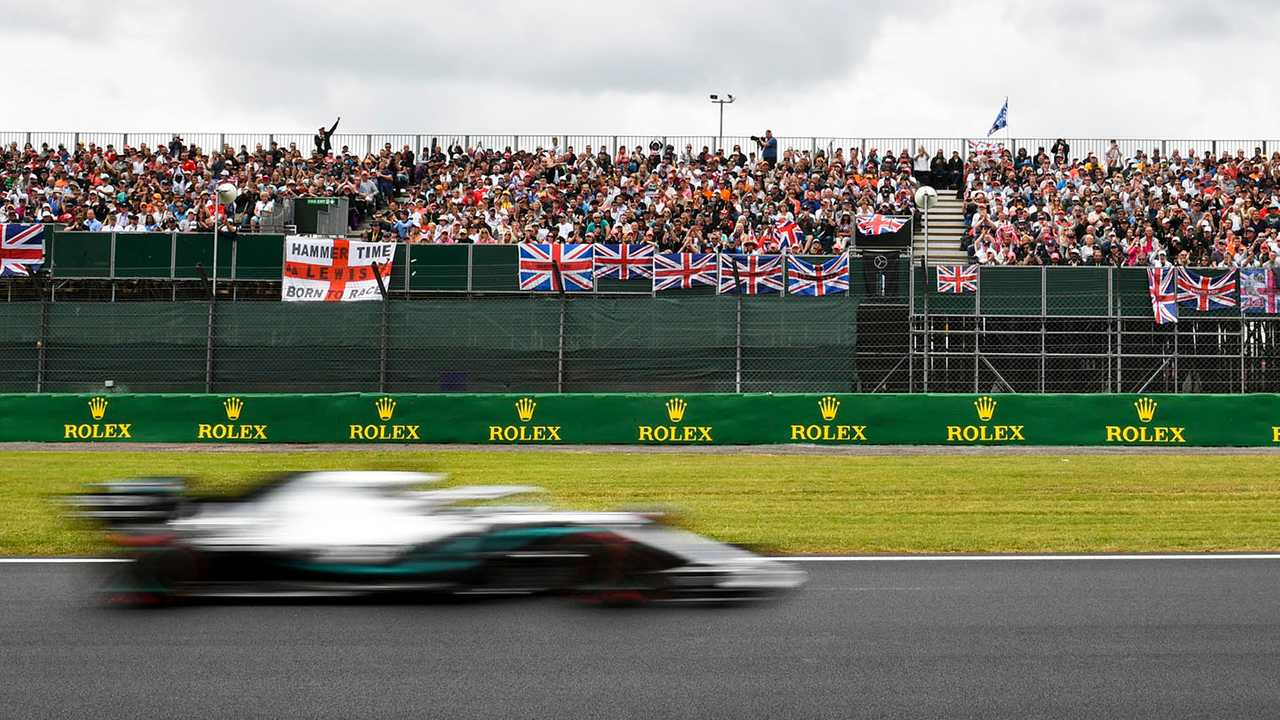 Lewis Hamilton, Mercedes AMG F1 W10, passes a grandstand full of support