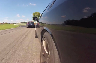 Watch the Dodge Challenger Hellcat Chase Down a Caddy on the Track