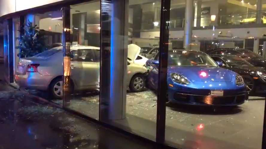Man Having 'Bad Day' Deliberately Crashes Into Porsche Dealer