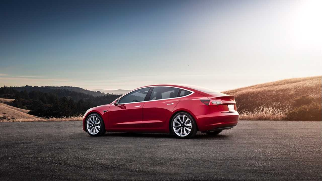 Tesla Model 3 sunset red