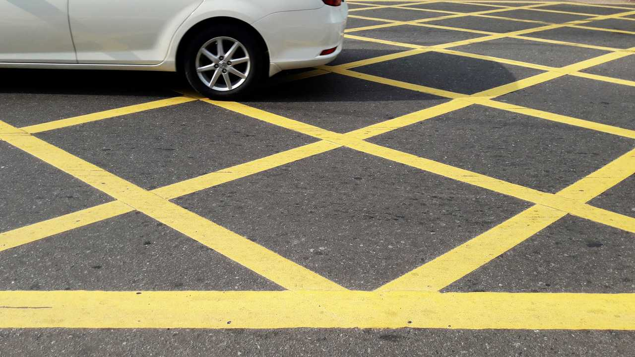 No parking yellow cross junction box zone on road