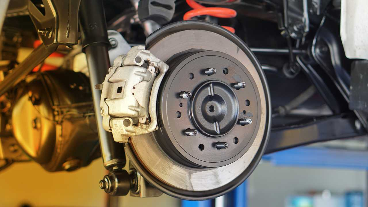 Disc brake service in garage
