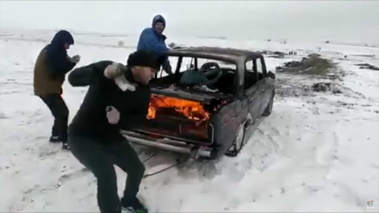 Flaming Car Jumped Into Frozen Lake