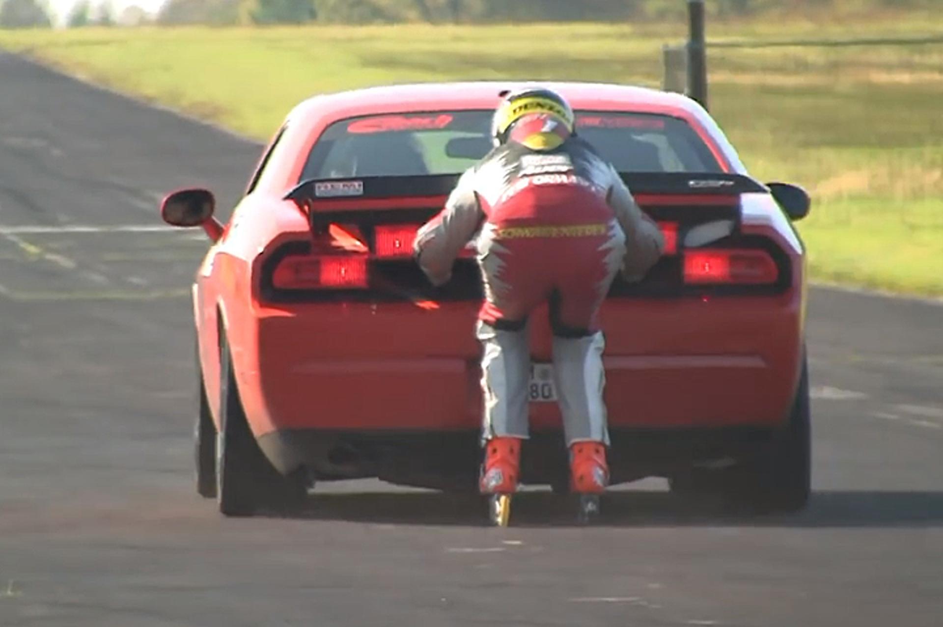 Guy Skates Behind a Dodge Challenger SRT8, Has A Lot of Guts
