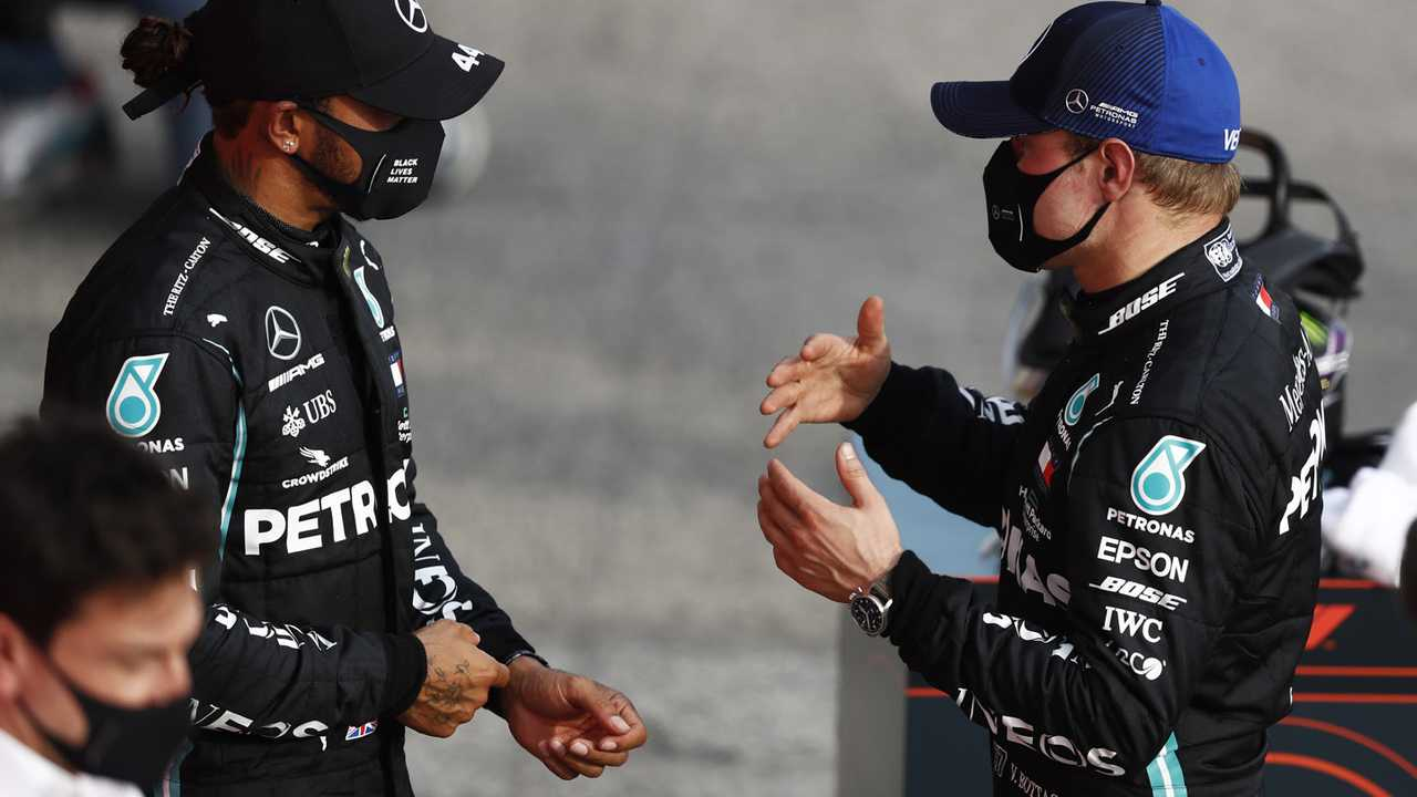 Lewis Hamilton, Mercedes-AMG F1, 1st position, and Valtteri Bottas, Mercedes-AMG F1, 2nd position, talk in Parc Ferme