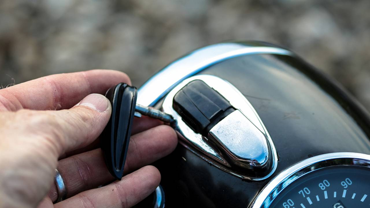 The ignition key fits into the front of the headlight and then can be turned left or right to turn on the headlight or the parking light.