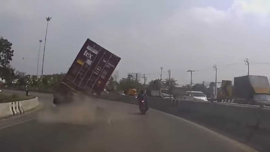 Biker Barely Escapes A Truck Rolling Over