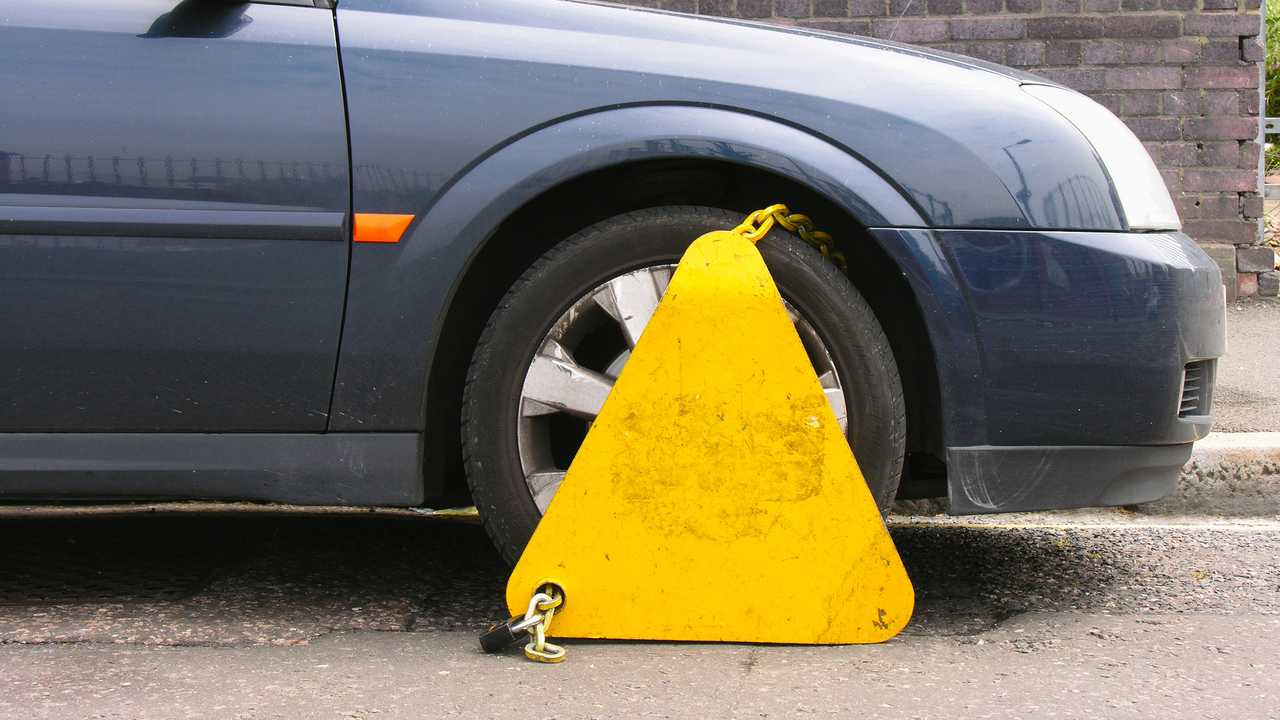 Clamped car in restricted parking zone