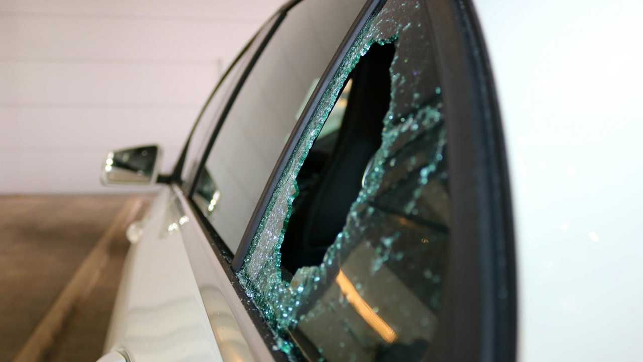 Broken car glass window from theft
