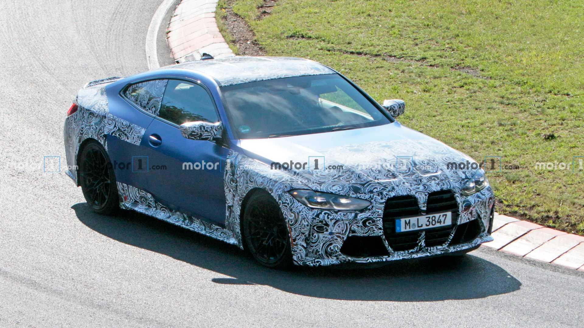 2020 - [BMW] M3/M4 - Page 19 2021-bmw-m4-at-nurburgring-front-three-quarters