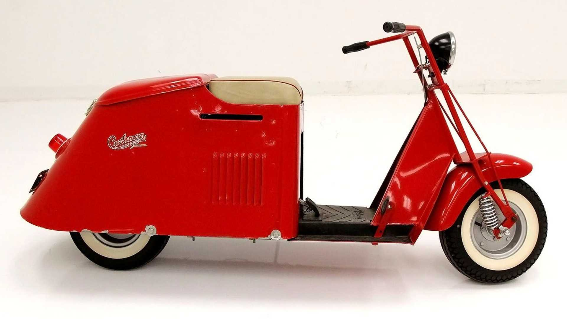 """[""""Take A Ride On This 1950 Cushman Step-Through Scooter""""]"""