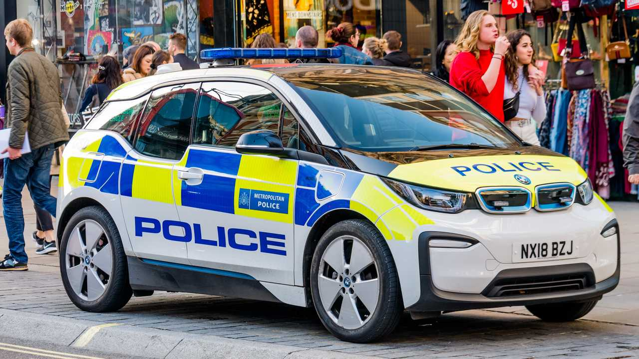 BMW i3 electric police car parked on Oxford St  in London